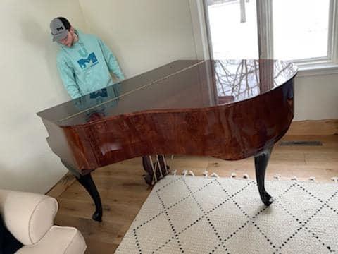 Unique Movers team preparing for a piano move in Little Falls, MN to Park Rapids, MN.